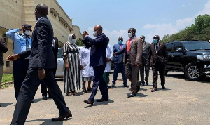 Burundi's Prime Minister Alain-Guillaume Bunyoni gestures as he arrives at the Prince Regent