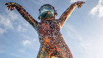 The  sculpture  is emblazoned with mathematical equations and words with a Michael Jackson pose