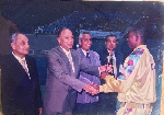 Wise being presented with the best defender award at the 1999 Nations Cup in Egypt