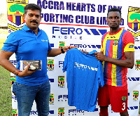 A Staff of Fero Mobile presenting an award to a player