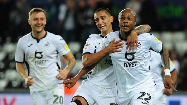 Andre Ayew powers Swansea City to victory over Wigan Athletic to climb back into the play-off