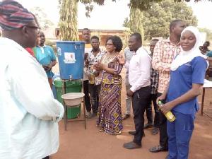 Hajia Zuwera Ibrahimah presenting Veronica buckets to Salaga government hospital