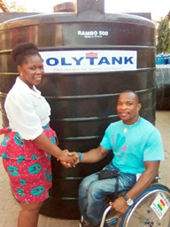 Maclean Dzidzienyo (right) shaking hands with Moudline Gyan after the presentation