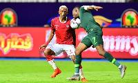 Madagascar's forward Charles Andriamahitsinoro (L) vies for the ball with Nigeria's Ahmed Musa