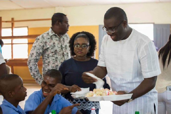 National Youth Organiser of the NPP, Sammi Awuku sharing cake with death and dumb students