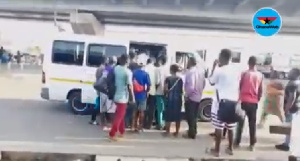 The passengers rushed to board the trotro