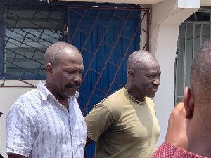Discharged Colonel Gershon Akpa (in army green shirt)