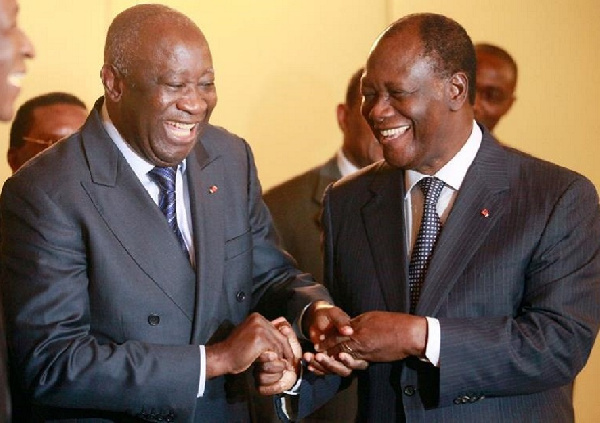 Ex-President of Ivory Coast Laurent Gbagbo and the country's present leader Alassane Ouattara