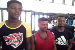 Suspects Collins Opoku Manu, (middle) Eugene Allon Nyame (left) and Michael Opoku