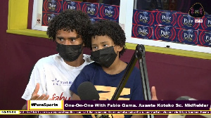 Fabio Gama with his son during a radio interview