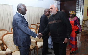 Rawlings greets Kufuor at a function.