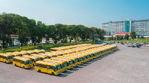 A photo of the buses parked at the forecourt of the Parliament House