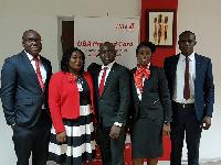 Richard Ahiagble, Theresa Adade with Johnson Olakunmi and his team from UBA
