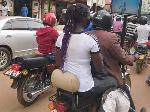 Okada rider places TV on his motor bike