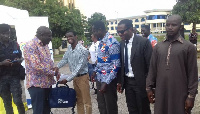 Executive Director of GIFEC, Mr. Kofi Asante donating the laptops
