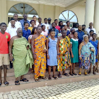 Some beneficiaries in a group photo with Committee members of the Asongli Education Fund