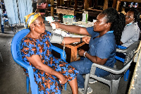 A resident of Adabraka undergoing medical review as part of the health screening exercise