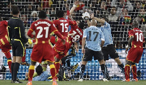 Luiz Suarez palmed the ball from entering the post