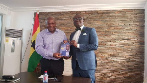 Former President John Mahama and Bola Ray take a picture after their meeting