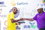 Sports Minister Mustapha Ussif presenting the trophy to Dabrah
