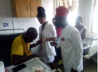 Nurudeen Iddrisu at the hospital with some of the victims
