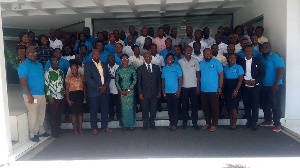Participant in a group photo after the conference