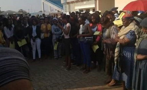 Scores of women waiting to buy the potion