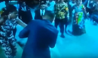 Bishop Obinim putting a ring on one of the single ladies he prayed for