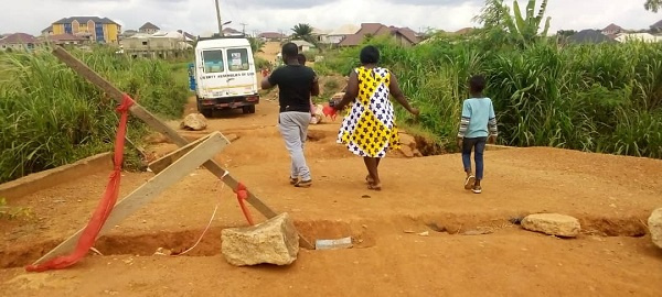 The state of the abandoned bridge project at Abuakwa-Apemhaase