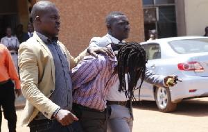 Gregory Afoko under arrest