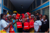 Executive Director of AFPNC (right) together with some mothers and officials of  Shoprite Ghana Ltd