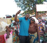 John Dumelo with Tamale market women