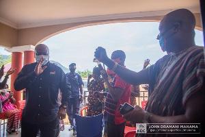 Former President, John Dramani Mahama exchanging pleasantries with Tongor traditional leaders