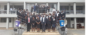 Some young Ghanaian lawyers in a group photo with High Court Judges