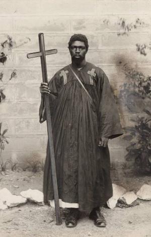 Kwame Sampson Oppong (c 1884-1965); holding his trade mark cross for evangelism in Kumasi