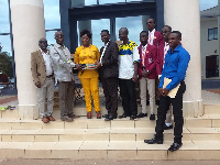 officials of PIE Ghana in a picture with officials of GSTS and Holy Family NMTC