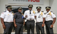 Liberia's IGP Mr Olivier Colman [M] with his delegation