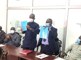 Emmanuel Afriyie with officials at the National Sports Authority