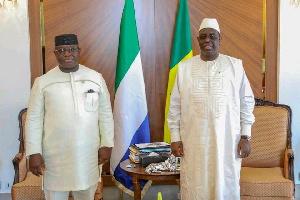 Sierra Leone president Maada Bio (left) and Senegal's Macky Sall had cause to celebrate