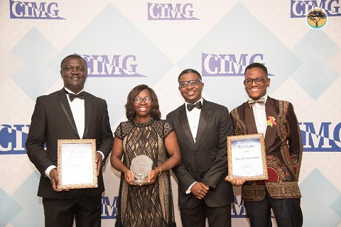 Staff of First National bank at the CIMG event holding their award