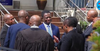 Dr. Stephen Opuni former CEO of COCOBOARD surrounded by his legal team