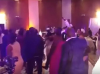 Guests at a wedding reception dancing to 'Onaapo'