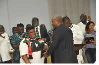 President applauding Jewel Ackah, one of the recipients of the awards