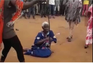 A photo of the 90-year-old woman, Madam Dente Akua on the floor
