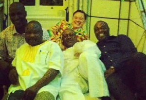 John Mahama pictured in bed with Andrew Solomon and others