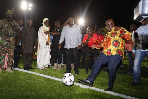President Akufo-Addo gives the first kick in the newly commissioned stadium