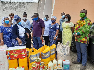 The Women's Ministry presenting the items to the officials at Nsawam Prison