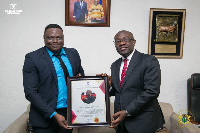 Mr. Oppong Nkrumah [R] receiving a citation from Kelly Nii Lartey [L]