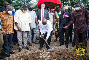 President Akufo-Addo digging the soil for the commencement of the project