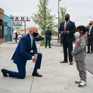 US Presidential Candidate, Joe Biden, kneeling in front of a young boy